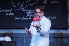 Joey holding brain in lab