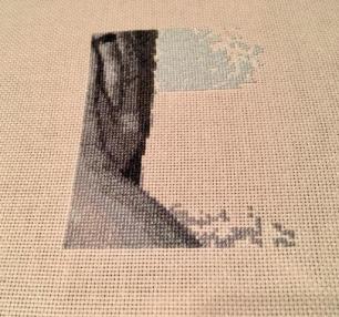 Cross stitching a photo.
