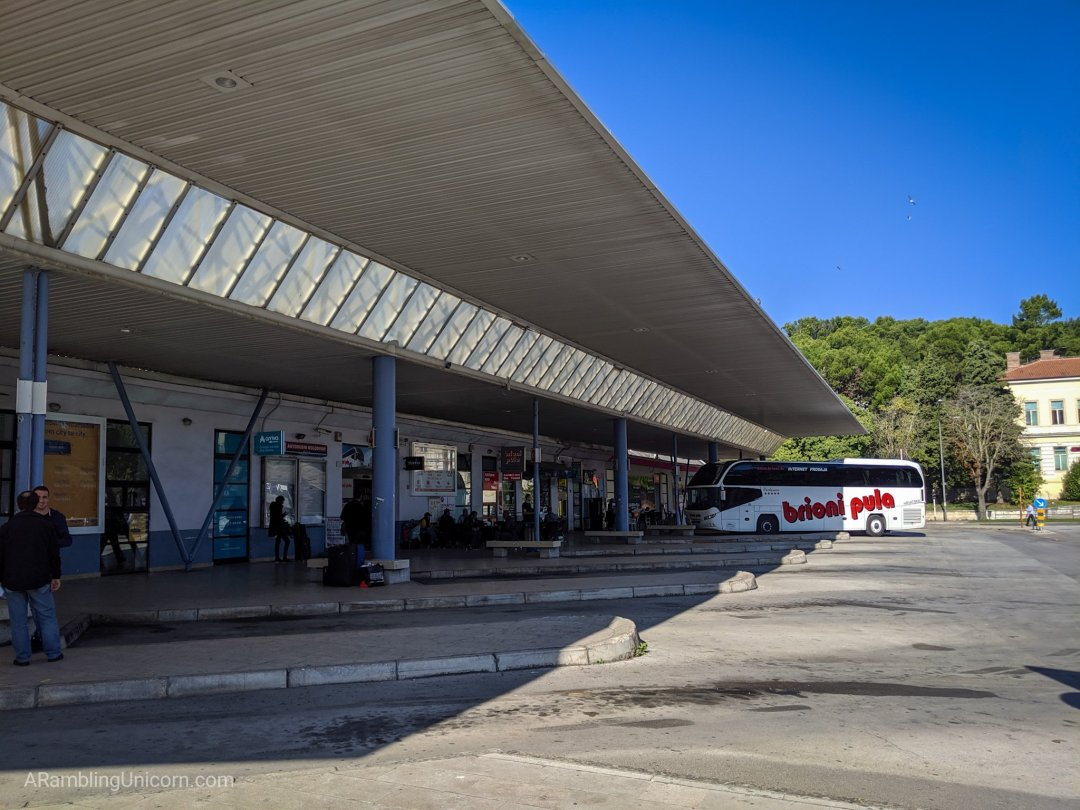 The Pula bus station with some bus parking spots.