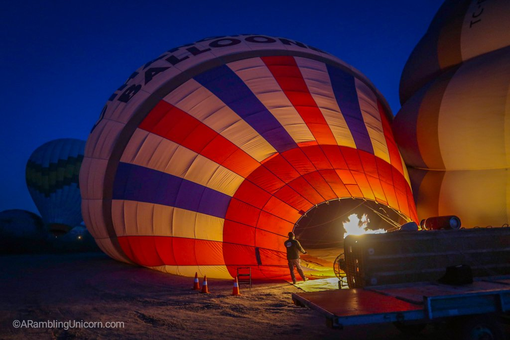 Preparing for the Cappadocia balloon ride: The hot air balloon is first inflated on its side.