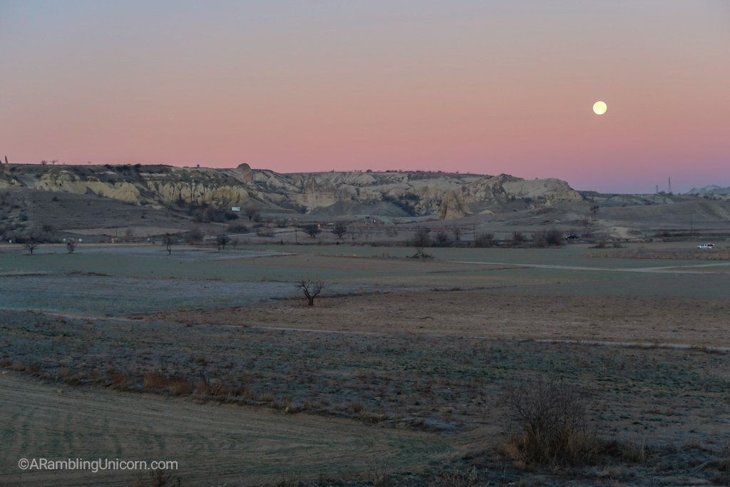 The full moon on the horizon.