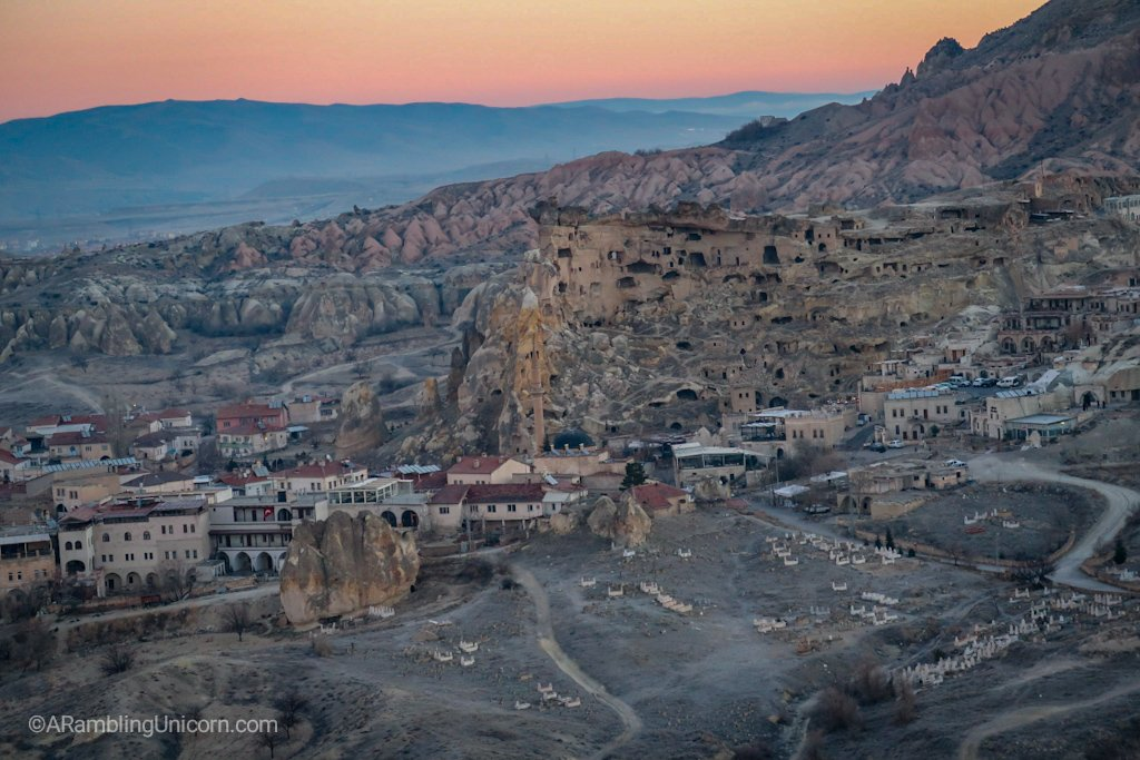 From the balloon we can see ancient dwellings carved into rock next to modern buildings.
