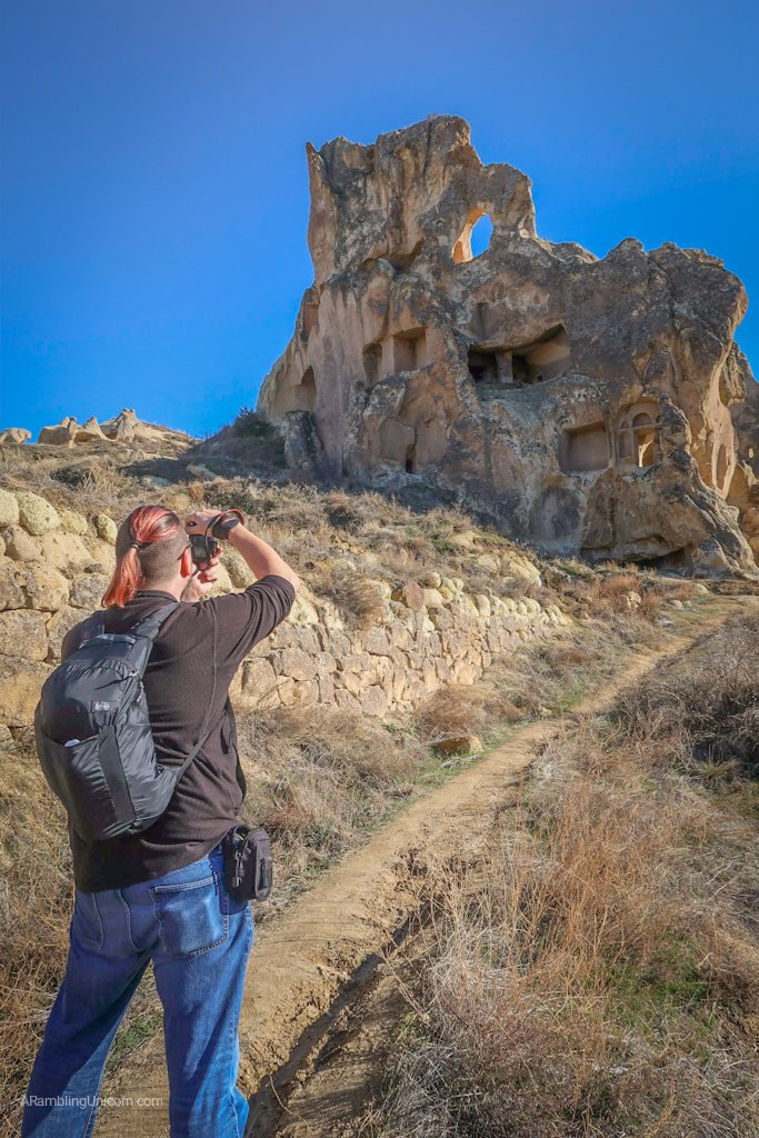 Cappadocia Itinerary Day 1: Daniel takes a photo of the cave dwellings near Göreme
