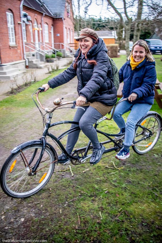 Tetris and I ride a tandem bicycle at Nordfyns Folk High School.