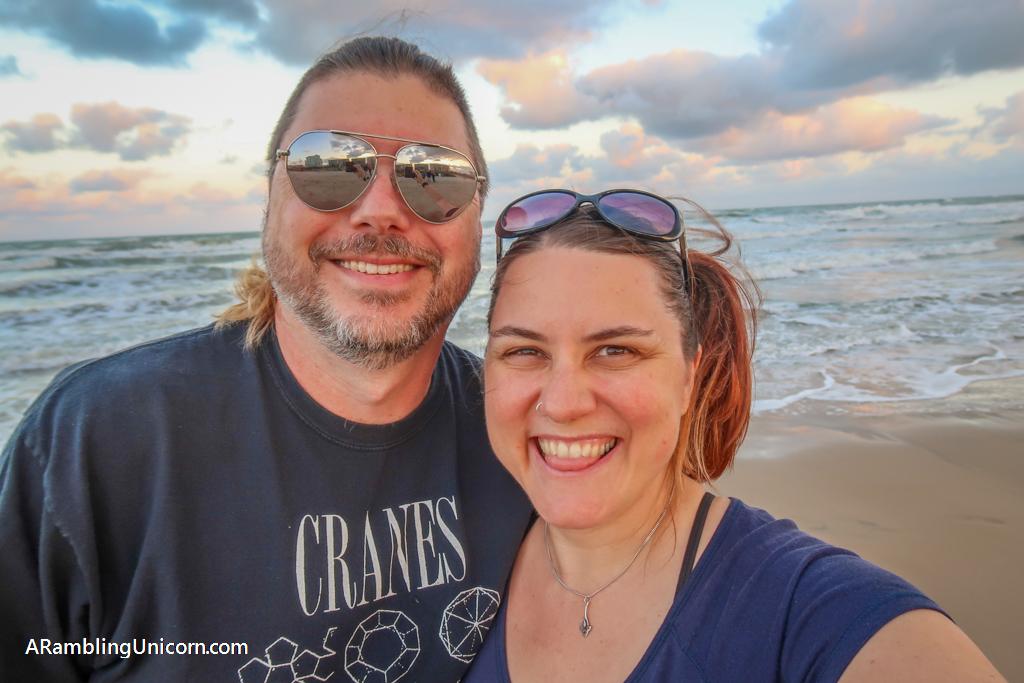 Daniel and I stand on the beach in South Padre Island, Texas