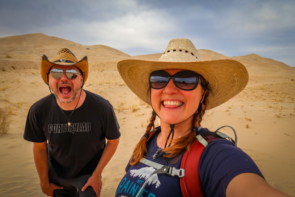 Selfie with Daniel and the author. Mounds of sand dunes are in the background.