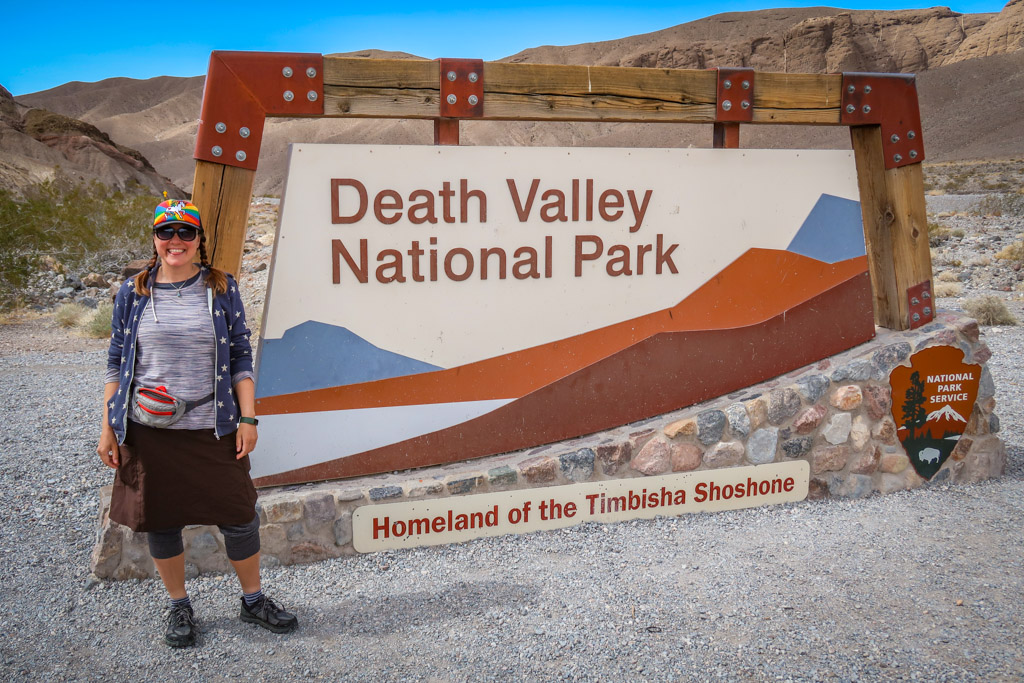 The author stands next to the Death Valley National Park entrance sign