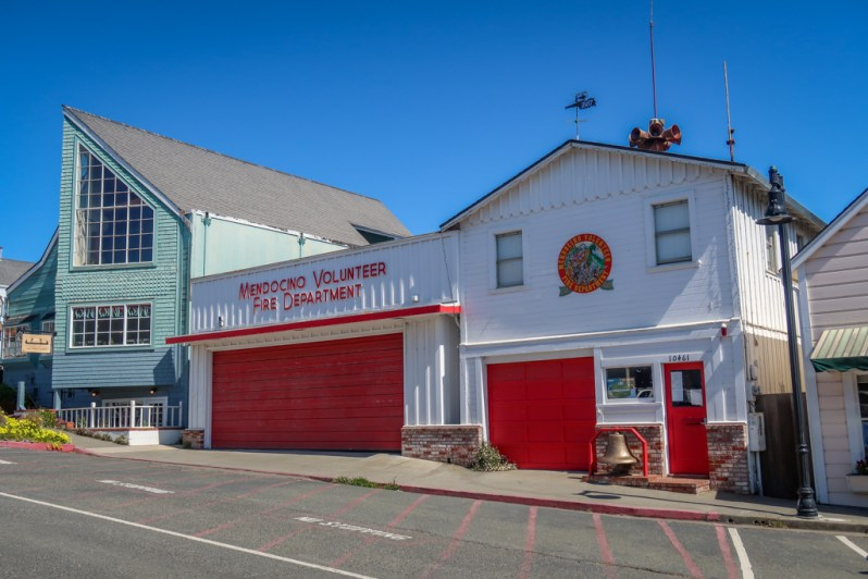 Mendocino Volunteer Fire Department building with a quaint red-and-white color scheme and an old-fashioned bell out front