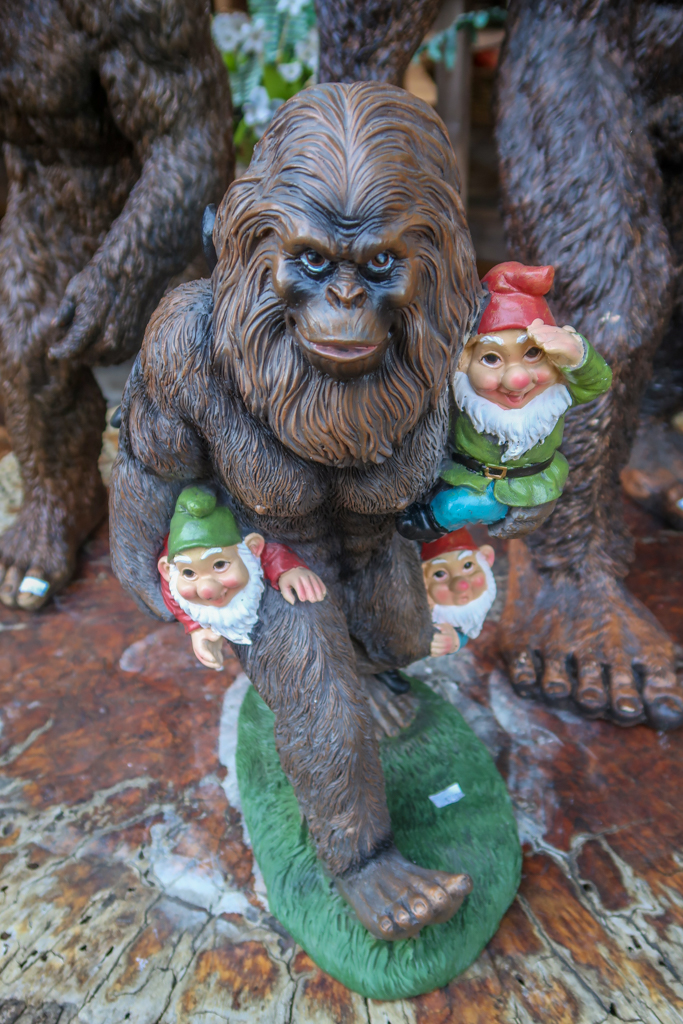 Statue of a sasquatch holding three adorable gnomes at the Legend of BigFoot gift shop.