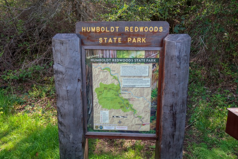 Humboldt Redwoods State Park sign at the beginning of the Avenue of the Giants auto tour, including a detailed map of the route.