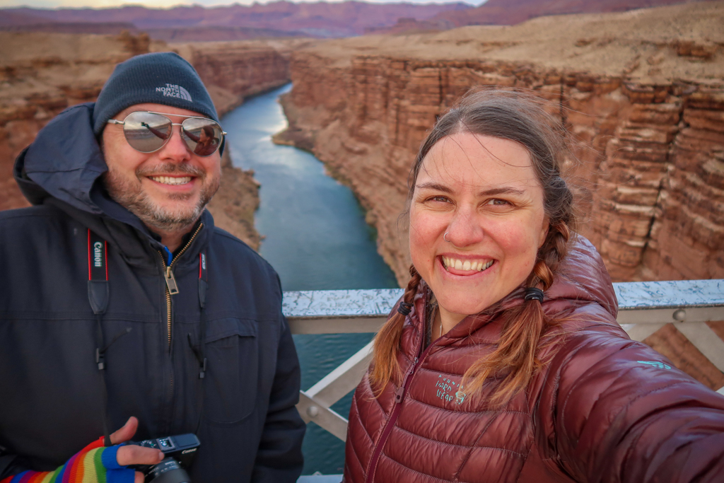 Photo of the author and her husband standing on the Navajo Bridge over Marble Canyon which is 470 feet tall.