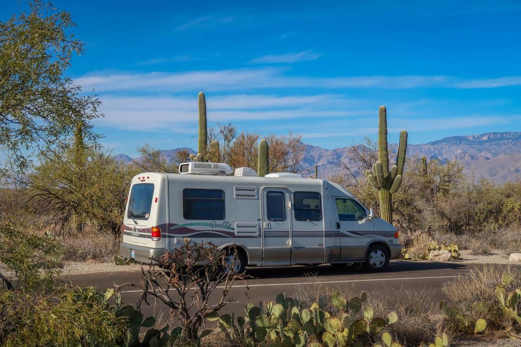 Winnebago Rialta parked among a Saguaro cactus forest at Saguaro National Park