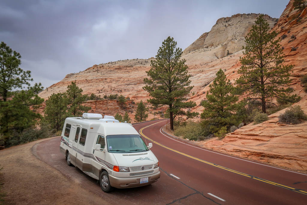 Winnebago Rialta parked along side the red cliffs on the Zion-Mount Carmel Highway in Zion National Park