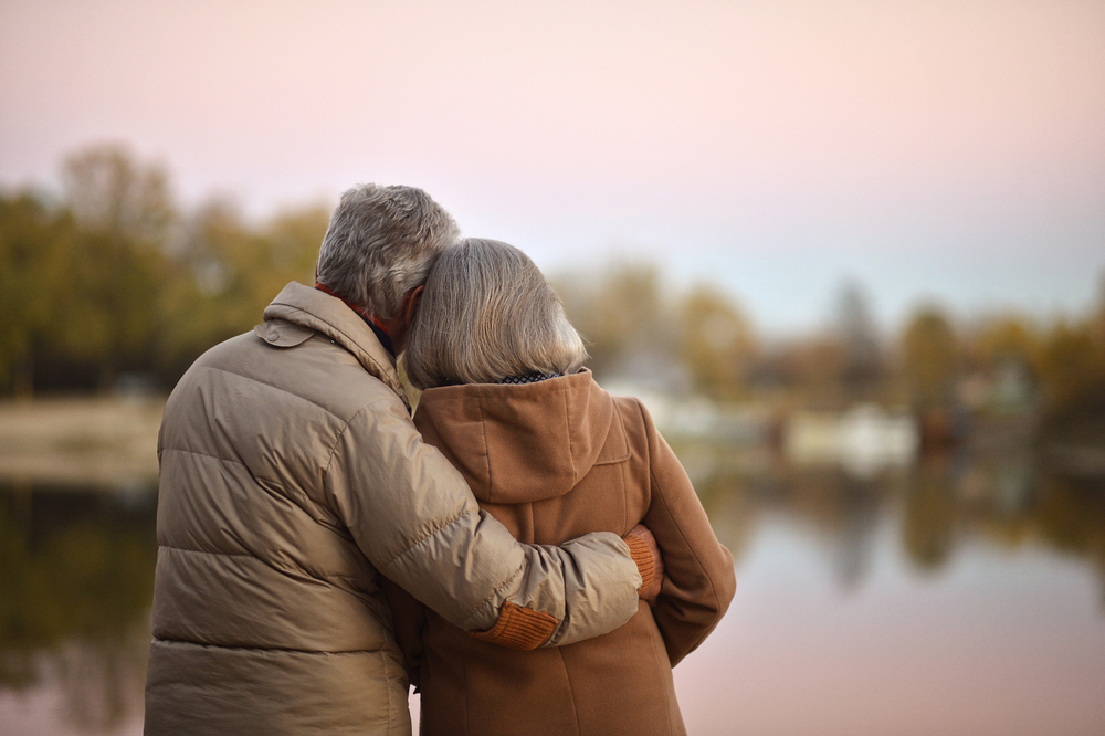 Mature couple looking at lake