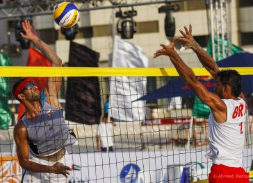 Abdullah Al Subhi(left) from Oman in action against Hassan Marhoon from Bahrain, during AVC Continental Beach Volleyball Zonal Tournament at Ajman Beach in Ajman.