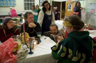 Syr Arlof and Isabella being serenaded by Mistress Analeda. Image by Jenn Miller.