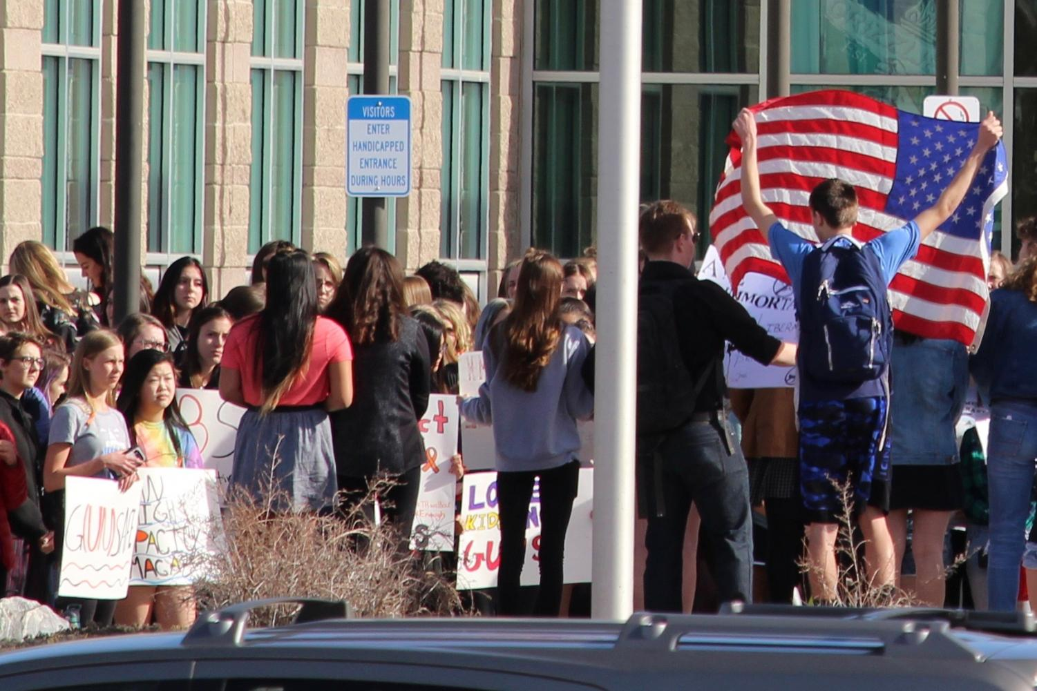 ThunderRidge students assemble in front of their high school on Wednesday, March 14, 2018, in Highlands Ranch, Colo. to express their concerns in the wake of the Parkland, Fla. shooting.