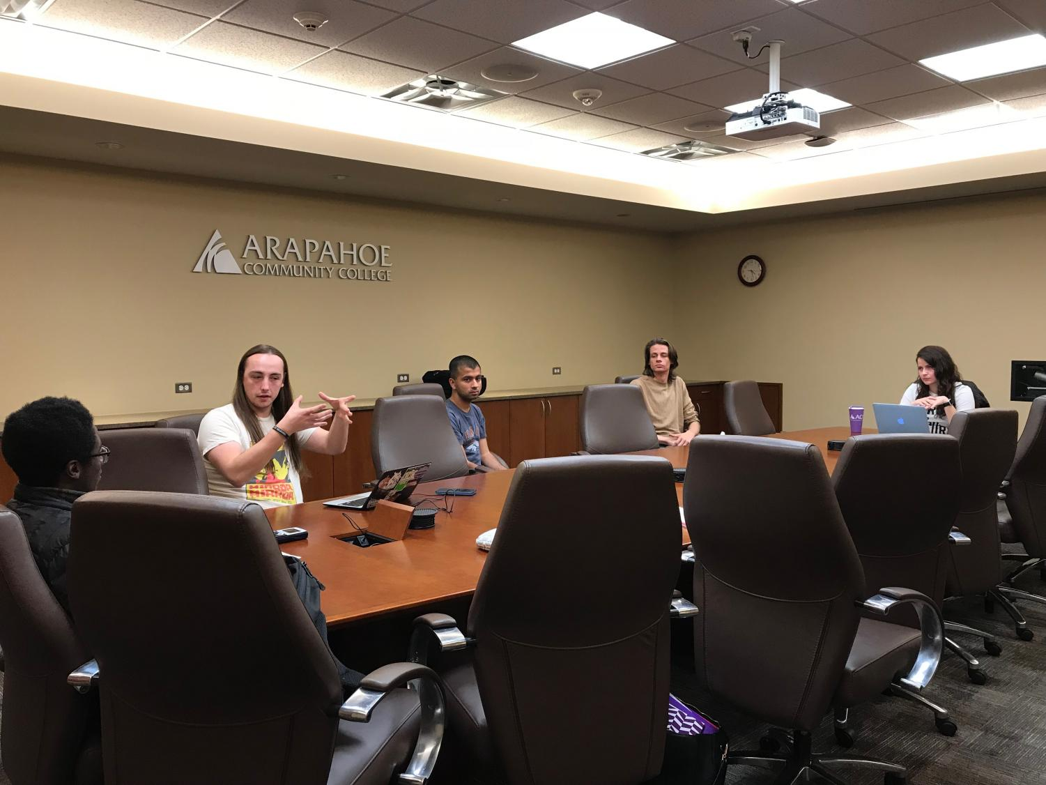 Student Government Associate Board Meeting, Thursday April 26, 2018 at ACC. In the far left, Treasurer John Sackey, to his right, Secretary Scott Bright. In the middle,  Aditya Sriram; middle right, Ryan Holmes, and to the right is President of Student Government, Camila Monroe.