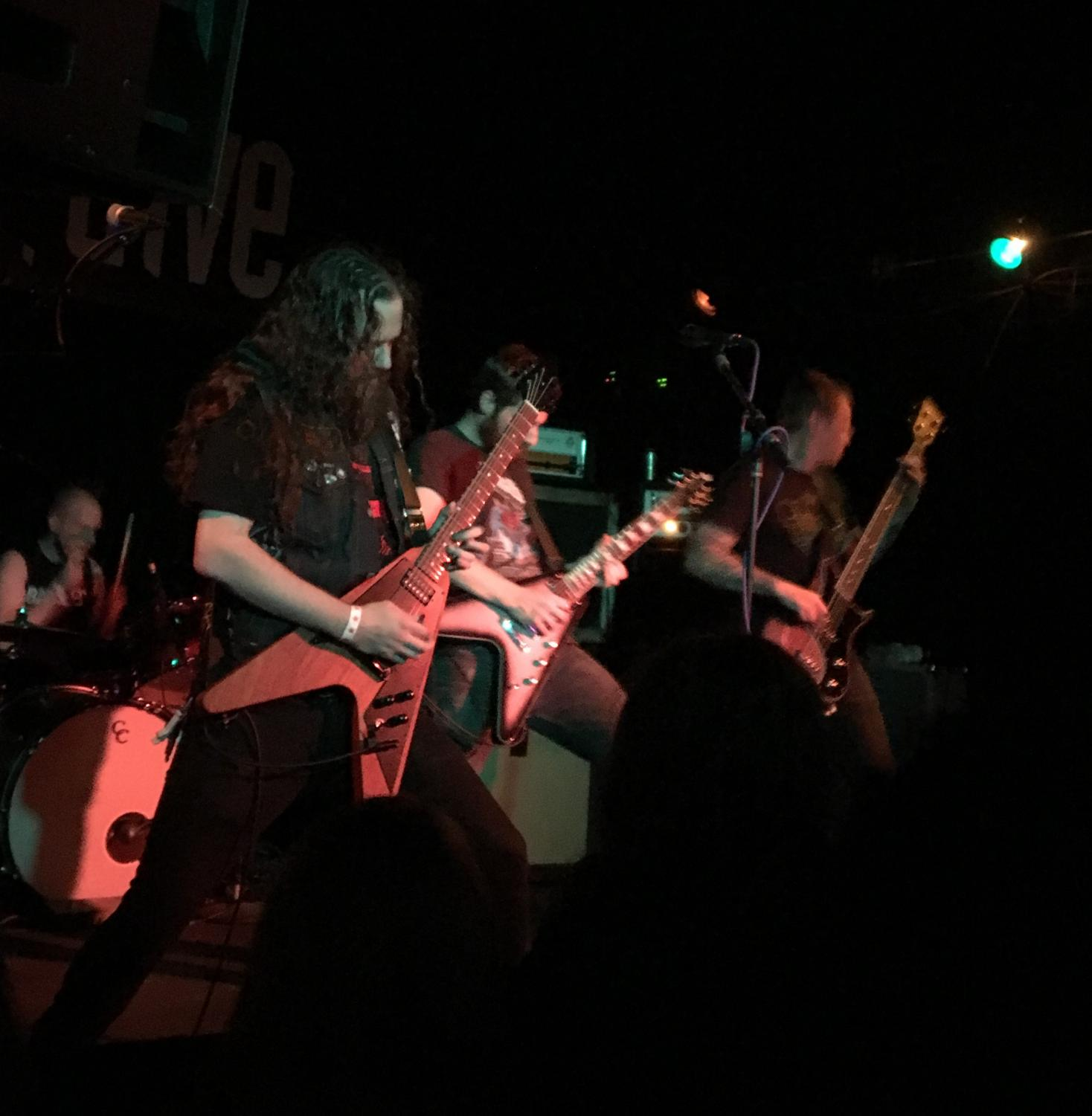 Khemmis performing at the Hi-Dive on Saturday, October 14, 2017 Left to right: drummer Zach Coleman, guitarist/vocalists Ben Hutcherson and Phil Pendergast, and bassist Dan Beiers. Photo by Jake Tharan.