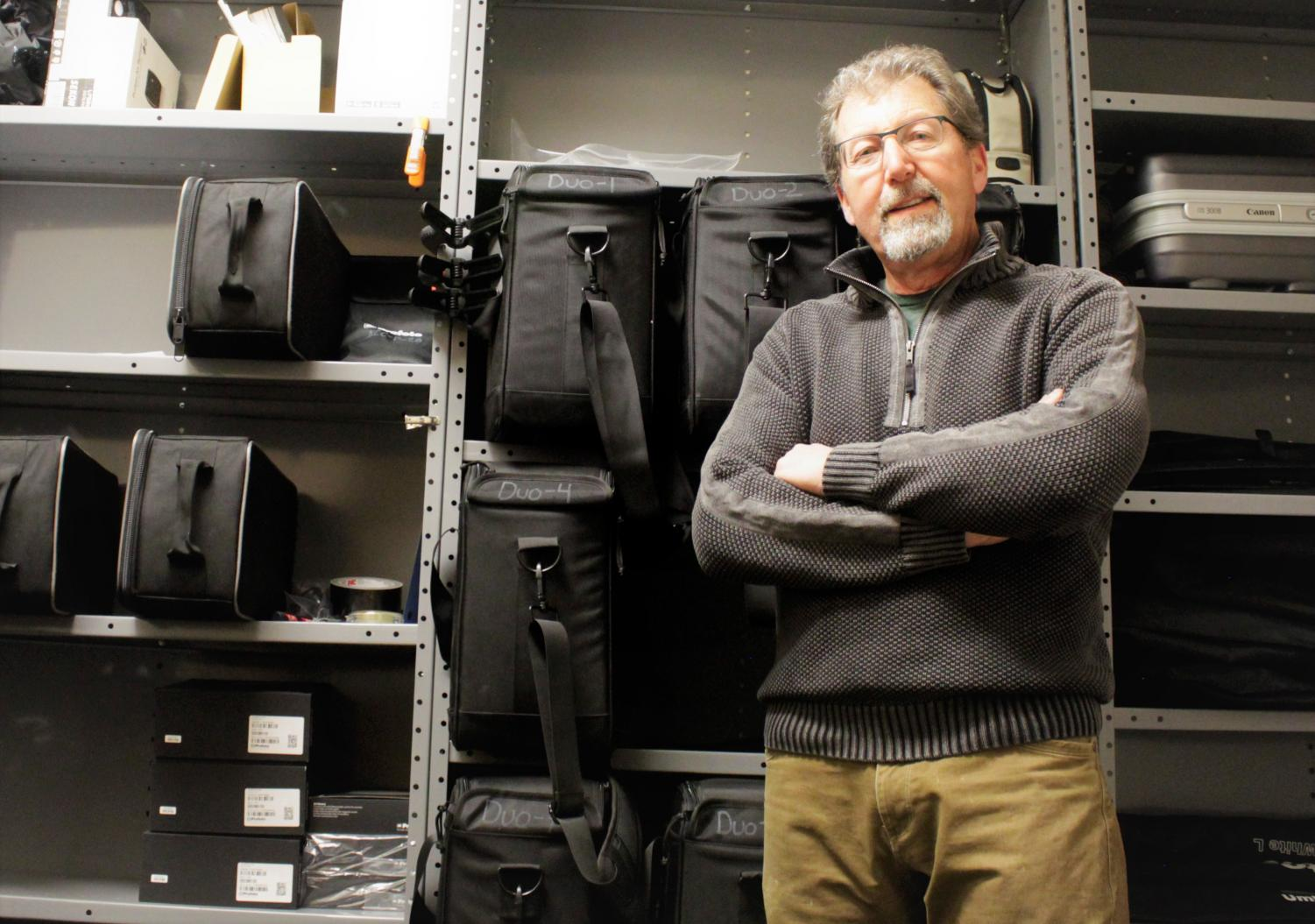 Brad Bartholomew, Head of the photography department at Arapahoe Community College displaying his vast array of camera equipment in the storage closet of the Arts and Design photography building on Feb. 19th 2019.