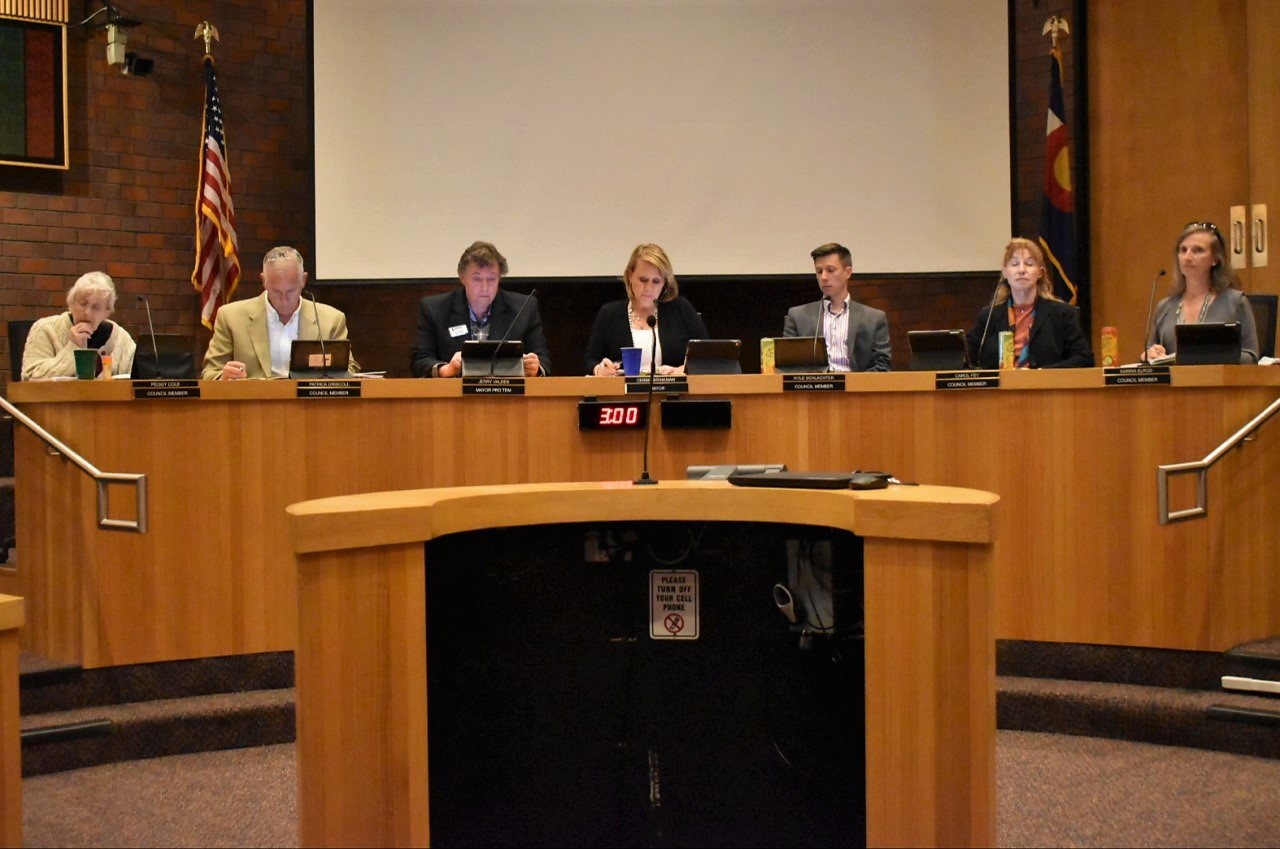 (Left to Right)  Littleton City Council members Peggy Cole, Patrick Driscoll, Jerry Valdes, Debbie Brinkman (middle), Kyle Schlater, Carol Fey and Karina Elrod initiate the April, 15, 2019 meeting in Littleton, Co.  The meeting addressed drainage, the youth committee and community in Littleton.
