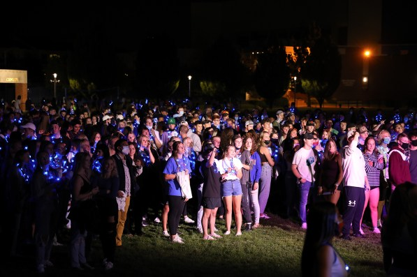 Large gathering of students hanging out on a field for Bronco Night on Boise State campus.