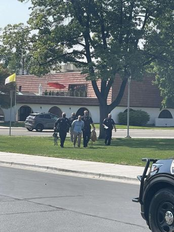 Keith Darrel in handcuffs getting taken off campus by Boise Police.