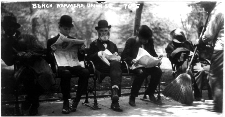 """Photograph of """"bench warmers"""" in a New York City park, reading newspapers c.1908, to illustrate the Index page for Kilrea & environs news accounts, 1735–1859."""