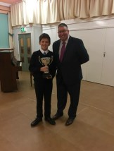 Thomas Kobine (under 12 ) Northern Counties Brass Band Association winner – receiving the trophy from Charlie Farren (Adjudicator) –January 2018