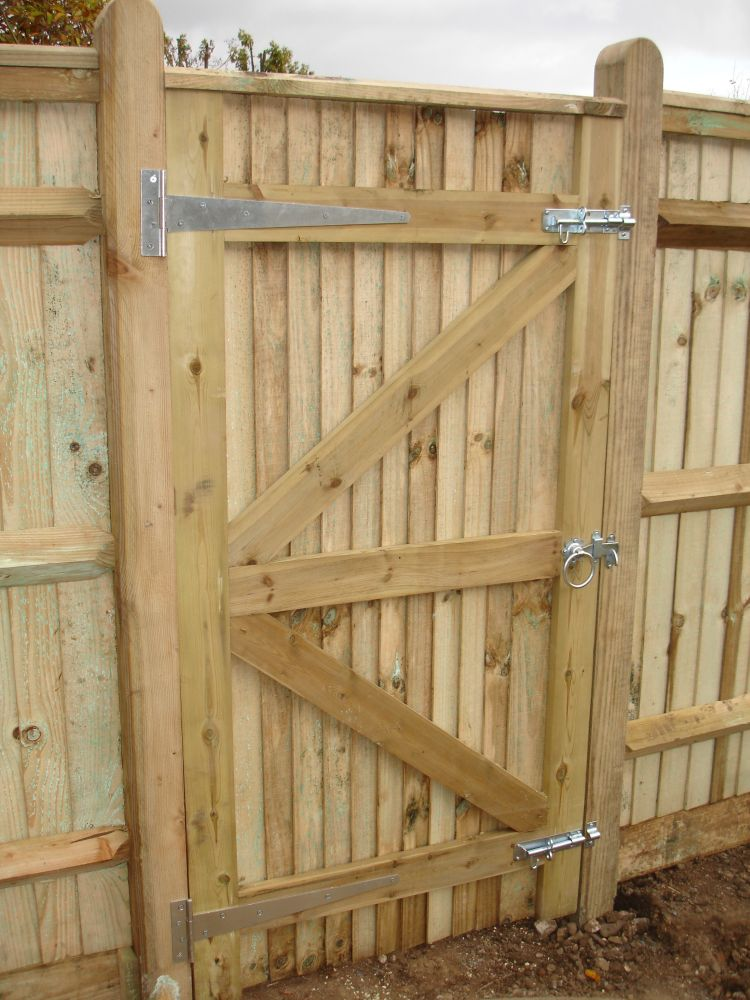 A close board gate with related ironmongery. Shoreham, West Sussex