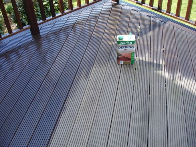 Deck oil being applied. Brighton & Hove, Sussex