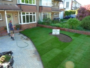 Premier turf being watered after laying. The edging really adds a finishing touch to the lawn