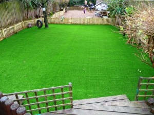 Nursery outdoor play area with artificial turf installed by Arbworx