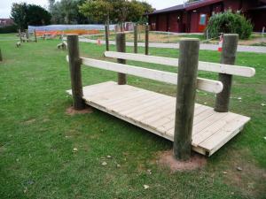 Robust timber playground bridge