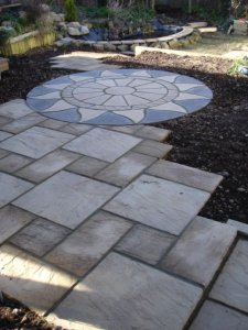 Decorative paving used to bring a contemporary feel to this garden
