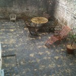 Full makeover using cobblestone paving for a walled courtyard garden