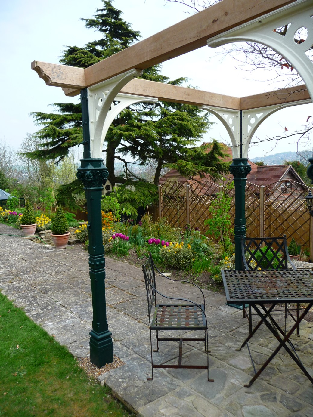 Reclaimed pillars from the West Pier in Brighton restored and installed into a garden in Withdean