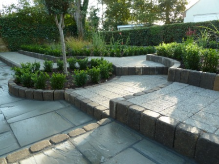 Award winning garden makeover, quadrant garden, Fairstone riven silver birch multi paving and cobblestone edging
