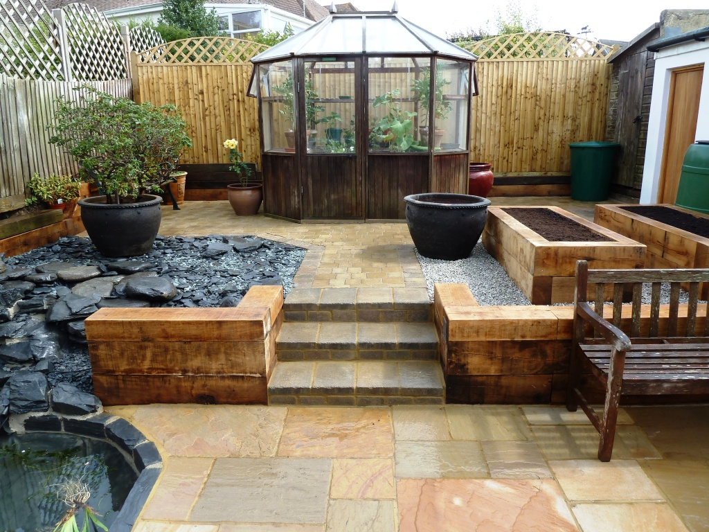 Indian sandstone paving, oak sleepers, garden makeover