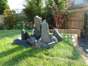 Complete garden makeover, 'waveform' Balau deck, Ipe corner seat, water feature, Haha, paving, lighting