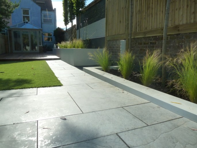 Marshalls casarta paving with black jointing compound.