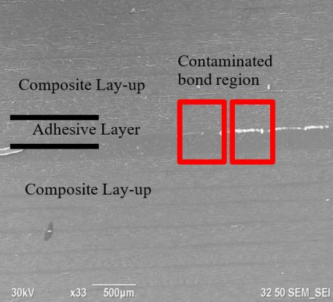 SEM image of contamination at bondline.