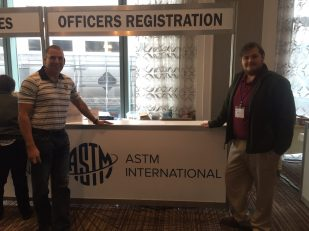 In this photo he is with Dr. Connor Nicholson from SRNL, a member of the Subcommittee and lead researcher on fixative technologies for the lab.