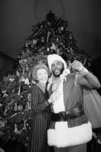 Nancy Reagan and Mr. T dressed as Santa