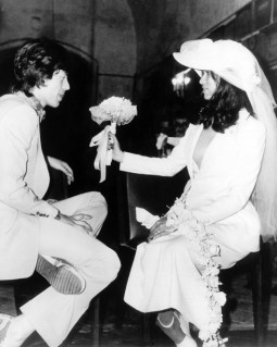 May 12, 1971. Mick JAGGER, ROLLING STONES singer poses with the Nicaraguan model Bianca PEREZ MARENA DE MACIA, the former wife of Eddy BARCLAY, in white wedding dress whom he has just married. As an ultimate extravagance of the times: the rainbow-colored tennis shoes Mick JAGGER is wearing. In 1978, the couple divorced and Mick JAGGER lost half his fortune in judicial costs. Le 12 mai 1971, en l'église de Saint-Tropez (France), Mick JAGGER, chanteur des ROLLING STONES pose avec la mannequin nicaraguayen, Bianca PEREZ MARENA DE MACIA, une ancienne femme d'Eddy BARCLAY qu'il vient de prendre pour épouse en blanc. Comble de l'extravagance à l'époque : les tennis bariolés de Mick JAGGER. En 1978, le couple divorce et Mick JAGGER perd la moitié de sa fortune en frais de justice.