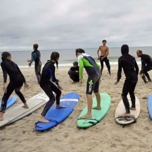 Surf lessons in Baja for groups with arc adventure trips.