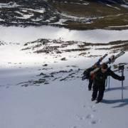 skiers climbing up sneachda