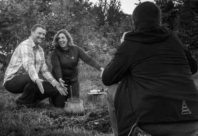 Dr. Barry Molloy photographs Jason O'Brien and Dr. Jerolyn E. Morrison, after a demonstration of Minoan cooking at UCD Centre for Experimental Archaeology ; Breaking the Mould Seminar Series