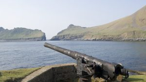 RCAHMS Field Survey Digital Photography A steel and concrete built gun-emplacement guards the pier at St Kilda village (NF19NW 1). The gun and sunken magazine were completed during October 1918 after a bombardment by a U-boat the previous May. View f