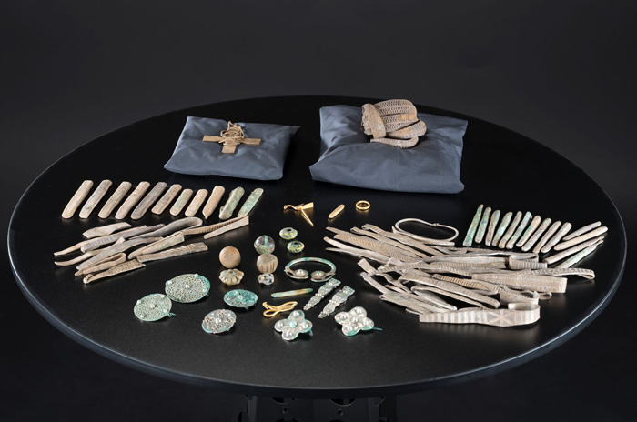 Items from the Galloway hoard, laid out on a table